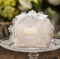 elfenbein geschenkboxen großhandel-Umweltfreundlich Hochzeit Boxen Elfenbein-Spitze mit bowknot Papier Süßigkeit Bevorzugungen 75 * 108 * 38mm über Geschenkverpackungen Hochzeit Party Supplies