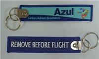 quitar etiquetas al por mayor-Azul Airlines Quitar Antes del vuelo Llavero Etiqueta de equipaje Zipper Pull Tejido Bordado Llavero 139x31mm 100pcs / lot