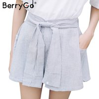 BerryGo Sexy hohe Taille Bogen gestreifte Frauen Shorts Röcke Sommer lose Tasche Knopf Shorts 2017 Casual Fringe Streetwear Shorts 17501