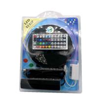 led bande rgb paquet achat en gros de-Bande LED RGB flexible 5M 300 LED 5050 60Leds / M Blister Package + Adaptateur + 44Key Télécommande Livraison gratuite