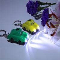 porte-clés de voiture solaire achat en gros de-Porte-clés solaire: voiture de dessin animé solaire, lampe de poche / lampe de poche / lampe de poche bouton