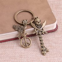 Barato Chave Antiga Do Crânio-2 peças / lote Metal Antique Bronze Key Charm Key Ring DIY Metal Skull Animal Pendant Jewelry Making C0245