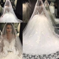 Wholesale Wedding Dresses Unique Necklines - Luxury Long Sleeves Wedding Dresses Sheer Neckline Sash Crystals Beads Unique Backs Princess Wedding Gowns With Long Train BOHO Bridal Dress