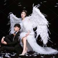 Wholesale black cosplay wings online - Big white Devil feather wings Cartoon performance Magazine shooting Fashion show large props Cosplay costumes EMS
