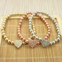 Wholesale New Fashion Crystal Stretch Bracelets - New York Fashion Crystal love heart charm Tone Copper beads Bracelets silver gold colors Stretch Beaded Bracelet jewelry for women men