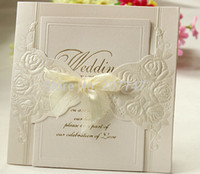 Wholesale Wedding Invitations Ivory Bow - Wholesale- Set of 100 Ivory Embossed Rosette Rose Flower Wedding Invitation With Organza Bows Party Invite Wedding Cards