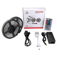 teclas ir mando a distancia al por mayor-Luz de tira del LED prenda impermeable flexible de 5M 5050 SMD RGB con el regulador remoto IR de 44 llaves con la fuente de alimentación de 12V 5A CE del CE 110V-240V