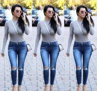 ingrosso collant lunghi delle signore-2017 Kim Kardashian Donna Camicia da donna Manica lunga Pagliaccetto Tuta stretta Rivetto Body sexy Body elasticizzato PF-019