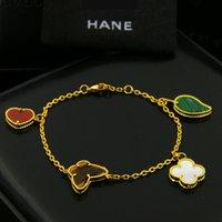 ingrosso braccialetto del trifoglio del fiore-Braccialetto di fascino delle donne della farfalla del fiore del trifoglio di quattro foglie placcate oro di alta qualità 18k nuovo per il regalo