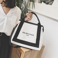 фирменные сумки оптовых-Оптовая мода характер дизайн женские сумки прочный холст пустой сумка простой черный цвет повседневная сумка многоразовые сумки