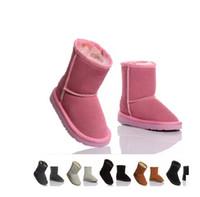 f2af19e968de2 2015 XMAS CADEAU Classique court Enfant botte de neige fille garçon bottes  d hiver enfants bottes de peau de vache bottes d hiver EU taille  25-34