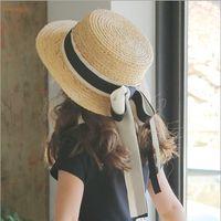 Wholesale Grass Shades - New Fashion Girls straw sunhats Cute Butterfly ribbon Kids sunhats Korean beach Trendy Sun Shade Children caps C2011