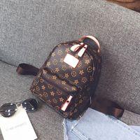 sacos de escola de designer para adolescentes venda por atacado-New FashionCasual PU Mochilas De Couro para Meninas Adolescentes Mochila Mulheres Floral Retro Mochila Escolar Bolsa de Ombro Sacos De Escola Designer Bolsa