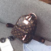genç kız omuz okul çantaları toptan satış-Yeni FashionCasual PU Deri Sırt Çantaları Genç Kızlar için Sırt Çantası Kadın Çiçek Retro Mochila Escolar Omuz Çantası Tasarımcı Okul Çantaları Bolsa