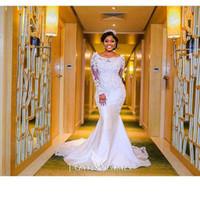korsett brautkleid mantel großhandel-2017 nigerianischen Brautkleider herzförmiger Ausschnitt mit schiere Spitze applizierten langen Ärmeln Kapelle Zug Länge afrikanische schwarze Mädchen Brautkleider