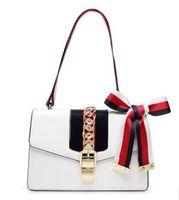 yay çanta çantası toptan satış-2017 Yeni Yüksek Kalite Moda Kadın Çanta Yay Hakiki Deri Süsleyin Omuz Zincir Çanta Tote PU Çanta Kolej Tarzı Parti çanta