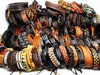 armbänder aus porzellan großhandel-Großhandelsmassenlose 100PCs / Lot mischen die Handgemachten realen Leder-Manschetten-ethnischen Stämme der Art und Weise der Männer Art und Weise Armbänder nagelneu