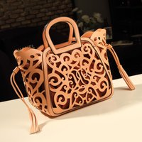 Wholesale Stripe Piercing - High quality handbags 2017 new spring tide Europe big fan hand bag basket ladies handbag bag pierced tassels
