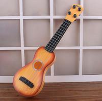 mini brinquedo de guitarra venda por atacado-Crianças bebê mini guitarra de plástico brinquedos brinquedo instrumento musical