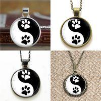 yin yang liebhaber anhänger großhandel-10pcs Tierliebhaber Yin Yang Paw Anhänger Tier Liebhaber Halskette Schlüsselanhänger Lesezeichen Manschettenknopf Ohrring Armband