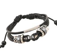 ingrosso braccialetti in rilievo in pelle-Braccialetti di cuoio di dimensione regolabile di colore misto nero / marrone 10PCS dei monili di modo degli uomini del braccialetto tessuto in rilievo dell'annata