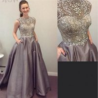 Wholesale Puffy Elastic Satin Evening Dresses With Sparkly Crystals Beading A Line Prom Dress Spring Sheer Cap Sleeves Special Occasion Gown