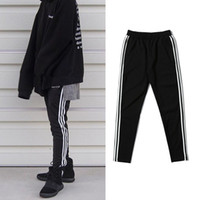 ingrosso joggers ansia magro-dongguan_wholesale in magazzino Mens di alta qualità Kanye West Jogger Pantaloni sportivi Justin Bieber High Street Pantaloni hip-hop Skinny Jogger Trousers