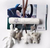 ingrosso giocattoli di attività dei bambini-I giocattoli molli del bambino del passeggiatore della greppia di attività sveglia della peluche di musica appendono il giocattolo di forma della stella del coniglio per i bambini Trasporto libero