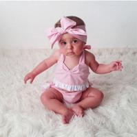 vestido pantalones chica diadema al por mayor-3pc set ins trajes de verano para niñas nuevas mameluco de color rosa con encaje vestido de mameluco infantil pastel pantalones cortos bebé gran arco diadema