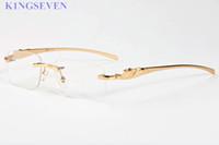 caja de color rojo al por mayor-gafas de sol de marca qulaity superior Hombres Mujeres gafas de cuerno de búfalo sin montura con caja de caja roja verde claro lentes oro Oculos Gafas lunetos