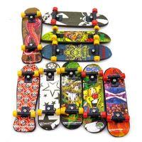 patineta para los dedos al por mayor-Venta al por mayor-3pcs Mini Stand FingerBoard Mini tablas de dedo con caja de venta minorista Skate camiones Finger Skateboard para niños juguetes para niños regalo hl051