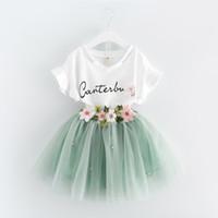 rock outfits koreanischen großhandel-Korean sommer 2017 baby mädchen kleidung kleid passt weiße brief t-shirt blume tutu rock 2 stück sets floral kinder kleidung outfits a488