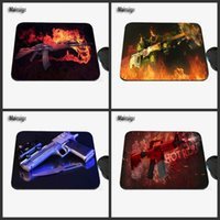 Wholesale photo guns - Computer Game Table Pad Super CSGO Counter Strike Gun Series Photo Print Rubber Rectangle Mouse Pad PC Computer Rubber Pad