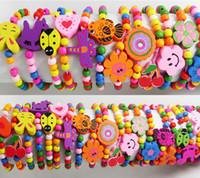 armbänder armbänder mädchen großhandel-Wholesale-60pcs Kinder Mädchen Holz Armbänder Kinder Armbänder 12 Design Mix Großhandel Geburtstag Party Geschenk Schmuck Lot