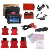 automotive diagnosewerkzeug tpms großhandel-XTOOL Original X100 Pad2 schlüssel programmierer mit 45 IMMO Unterstützung EPB EPS OBD2 Entfernungsmesser OilRst TPMS TPS X100 PAd 2 Besser als X300 pro3