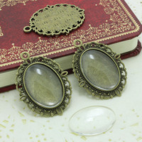 cloches en verre antique achat en gros de-Doux Bell antique bronzer filigrane camée cabochon 18 * 25mm base pendentif plateau + cabochons en verre transparent D0214