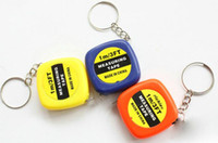 Wholesale Portable Back - 150pcs Small tape measure 1 meter portable mini soft tape measure ruler keychain pendant small gifts gift metric inch tape measure