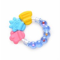 Wholesale Silicone Teether Molar Training Tooth Grab and Spin Rattle Bell Toy For Infant Baby teethable textures