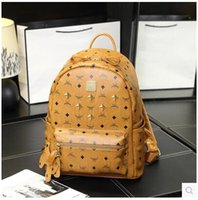 Wholesale Rivet Solid - High-end quality new arrivel designer fashion korean men school backpack hot selling brand Punk rivet women shoulder daypack student bags