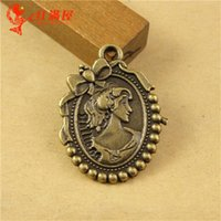 Wholesale Bow Cameo - 21*27MM Antique Bronze alloy beauty head manual DIY retro jewelry wholesale oval bowknot bow cameo lady charm pendant beads lot