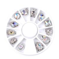 encantos de la rueda de aleación al por mayor-Nuevo 12 unids / caja Nail Art Rhinestone Charm Clear AB Aleación Nail Crystal Decoraciones Rueda 3D Mix Designs Manicure Tools 2017 Venta