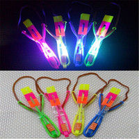 Wholesale Led Helicopter Slingshot - New LED Arrow Helicopter Umbrella Amazing LED Light Flash Funny Slingshot Flying Toys Flash Elastic Rocket Copters