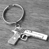 chaveiro da pistola venda por atacado-12 pcs Gun Chaveiro Gun Chaveiro Prata Gun Acessório Revólver Revólver Shotgun Pistola Cowgirl