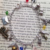 Wholesale braclet links - 6pcs lot HP inspired Charm Bracelet envelope star train book dragon charm braclet.
