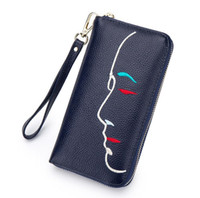 Wholesale Selling fashion ladies wallet embroidered long wallet zipper bag brand joker head layer cowhide hand bag