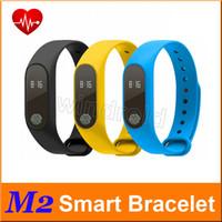 ingrosso braccialetti di salute-Wristband astuto della fascia dell'inseguitore di idoneità di salute di Bluetooth Smartband del braccialetto di frequenza cardiaca del braccialetto astuto di M2 per Android iOS Trasporto libero 10pcs