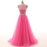 lentejuelas color rosa caliente formal al por mayor-Impresionante vestido de fiesta rosa caliente Vestidos largos de fiesta de noche formales Una línea Pura cuello Cristales Cuentas Granos Lentejuelas Tul Vestidos de baile Tren