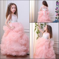 Wholesale Glitz Pageant Dresses Designs - Blush Pink Girl's Pageant Dresses 2018 New Sheer Jewel Neck with Beads Cascading Ruffles Unique Design Child Glitz Pageant Gowns MC1290