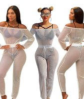 Wholesale hot sale women jumpsuits women long sleeve sexy club see through bodysuit black white hollow mesh bodycon off shoulder african jumpsuit