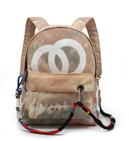 Wholesale travel bags backpack price for sale - Factory Price Fashion New Distress Graffiti Printed Women Men Canvas Backpack Embellished with Multicolored Ropes School Travel Bags